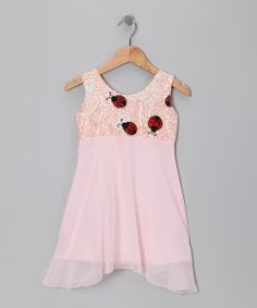 Let little ones crawl into this comfortable, hand-beaded sequin ladybug dress with a flowing chiffon skirt that resembles the delicate petal of a flower. A stretchy top with a half zipper in the back makes it easy to slide onto squirmy kids.85% rayon / 15% spandexHand wash; dry flatImported