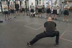 """Tim """"Red"""" Wakeham, Michigan State University strength and conditioning coach, demonstrates some manual resistance exercises to help improve Tactical Air Control Party instructors' weight training curriculum about at Joint Base San Antonio-Lackland Medina Annex Feb. 1, 2017."""