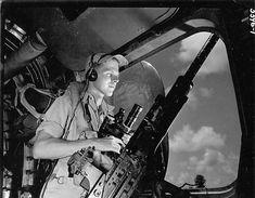 Waist Gunner in Position on B-24 Liberator During Mission | World War Photos