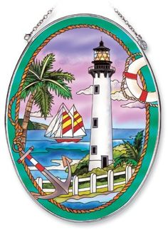 Amia Oval Suncatcher with Cape Florida Lighthouse Design, Hand Painted Glass, 6-1/2-Inch by 9-Inch by Amia. $23.21. Comes boxed, makes for a great gift. Handpainted glass. Includes chain. Amia glass is a top selling line of handpainted glass decor. Known for tying in rich colors and excellent designs, Amia has a full line of handpainted glass pieces to satisfy your decor needs. Items in the line range from suncatchers, window decor panels, vases, votives and much more.