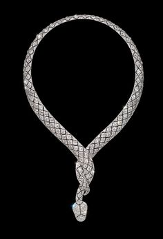 A diamond serpent necklace,    in the form of a snake, the platinum body finely set with old   brilliant cut diamonds in a bombé scale pattern, its   body entwined to form the neck.    Paris, circa 1919.    Attributed to the Lavabre workshop. Lavabre supplied Cartier Paris  with diamond set jewels and a necklace of identical design made by   Lavabre for Cartier is held in the Cartier Collection.  http://www.wartski.com/Necklace%20diamond%20snake.htm