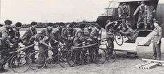 Engineers of the 249th Field Company load their folding bicycles aboard a Horsa.