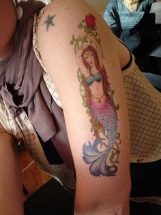 I have this mermaid in a bookmark - it looks really great as a bigger tattoo. I love the details in the whole tattoo along with the soft color shades!