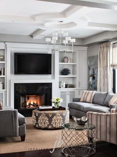 Briar Rose living room/den designed by Jennifer Brouwer Design.   Love the patterned ottoman.