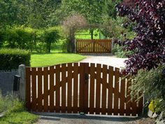 Simple wooden gates in a beautiful Normandy garden.