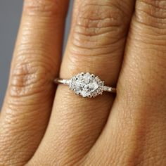 This ring gives us that Friday feeling ALL the time 💍 It features a half-carat princess cut diamond with clusters of accents on each side!  JosephJewelry.com | Designed and created by Joseph Jewelry | Seattle, WA | Bellevue, WA | Online | Design Your Own Unique Engagement Ring | #engagementring Dainty Engagement Rings, Design Your Own Engagement Rings, Diamond Cluster Engagement Ring, Princess Cut Rings, Princess Cut Engagement Rings, Alternative Engagement Rings, Beautiful Engagement Rings, Princess Cut Diamonds, Princess Cut Wedding Sets