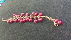This is a red glass bead woven bracelet