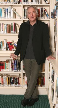 Alan Rickman and books. Ooh, the passion we could share pressed up against those bookshelves...