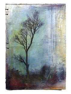 Testament is a handbound blank journal with original mixed media covers. The artist is Bridgette Guerzon Mills.