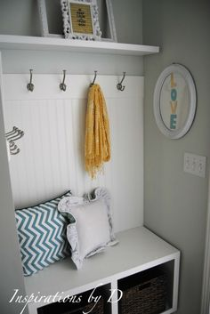 Small Mudroom. I don't really love the style of this, but the idea of hooks + a shelf would work SO WELL above our current entrance bench... Hmm...