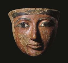 An Egyptian Wood Mask, Late New Kingdom, 1080-712 B.C., 23 cm