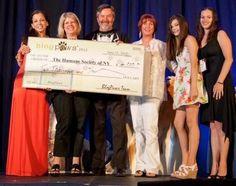 Wendy Diamond  & BlogPaws team with donation check to Humane Society of New York.
