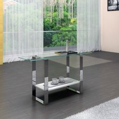 Clarity Console-------The Clarity Console features a light and streamlined tempered glass top supported by chromed metal legs. This minimal modern piece adds a pure and simple yet eye-catching element to any contemporary space.