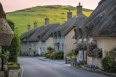 Lulworth, Dorset, England A beautiful row of cottages greets each visitor heading down this hill towards Lulworth Cove. Not a bad introduction to a beautiful village along the Jurassic Coast of southern England English Country Cottages, English Village, English Countryside, English Farmhouse, Country Homes, Beautiful World, Beautiful Places, Jurassic Coast, England And Scotland