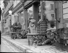 BRITISH ARMY FRANCE 1940 (F 3019) Vickers machine guns of 1/7th Manchester Regiment, 3rd Division, set up outside shops in St Pol, 8 March 1940.