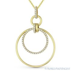 The featured pendant is cast in 14k yellow gold and showcases multi-circle pieces adorned by round cut diamonds.  #diamonds #14kjewelry #14kgold #yellowgold #circles #pendant #necklace