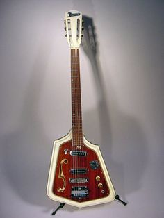 A DOmino California Rebel. With the slotted headstock and stylized f-hole, this is very unique. From Mike Robinson's collection, reported in Premiere Guitar.