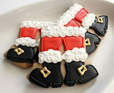 Use a onesie cookie cutter to create these Santa cookies - one of 3 parts - elves, too! from lovefromtheoven.com