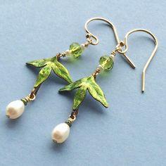 Trident leaf earrings w/ light green crystal & F.W. pearl drop. Brass, crystal, F.W. pearl, G.F. findings, G.F. ear wires. by JewelspringGirl on Etsy