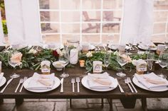 30 Rustic Wedding Centerpieces That Go Beyond the Basic Mason Jar - Yes, it IS possible to have a rustic wedding without mason jars — trust us. Say hello to these stylish rustic wedding centerpieces that are anything but overdone. rustic wedding tablescape with greenery runner and low candle centerpieces fall
