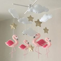 Flamingos, clouds and stars baby crib mobile. An ideal gift for a new babys nursery or room decor in an older childs bedroom. This mobile consists of five white clouds, six gold stars and four elegant pale pink flamingos with beautiful bright pink wings. The elements are suspended with