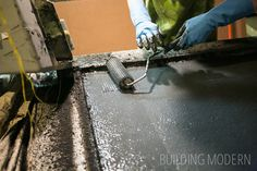 Kitchen: diy concrete countertops – making concrete countertops reinforced with glass fibers. Packing in layers of concrete, then compacting with rollers.