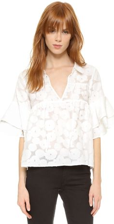 Light airy white top with bell sleeves and fold over collar. For Love & Lemons Buttercup Blouse