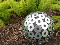 Add sparkle to your planting beds with a gazing ball. All it takes is an old bowling ball, some glue and your choice of decorative pieces.