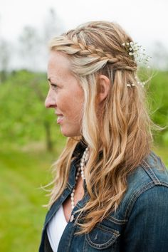 This look combines two of our favourite wedding hair style trends: waves and braids. For a boho feel, this bride braided the front sections of her hair and had them pinned back to create a pretty demi-chignon.