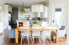 Kitchen Nook with blue end chairs || Studio McGee  Lighting over breakfast table