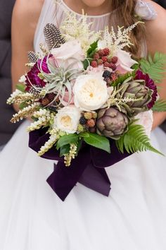 Bridal bouquet of artichokes, feathers, airplants and blooms | poppyandmintfloral.com | Photo by Nichols Wedding Photography