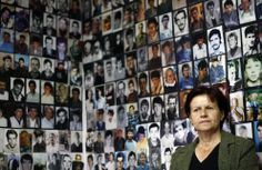 A Bosnian Muslim woman from Srebrenica, sitting under pictures of victims of the genocide in the town during the 1992-1995 Bosnian war, watches the broadcast of Ratko Mladic's court proceedings, in Tuzla, on June 3, 2011. Mladic was indicted over the 43-month siege of the Bosnian capital Sarajevo and the massacre of 8,000 Muslim men and boys in the town of Srebrenica, close to the border with Serbia, during the 1992-95 Bosnian war. (Reuters/Dado Ruvic)