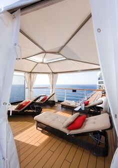 Ahhhh....Cabana overlooking both the ocean & pool complete with robes, chilled water, fruit basket, champagne & chocolate covered strawberries.  Holland America Eurodam & Nieuw Amsterdam ships.