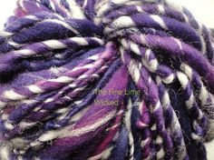 Handspun Purple Glow in the Dark Yarn Superwash by thefinelime