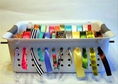 Use a slotted tupperware bin to store leftover ribbon.
