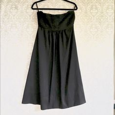 Banana Republic black silk strapless dress Banana Republic black silk strapless dress. Midi length below knee. Pleated at chest. Petticoat liner. Side zip. Size 4. Third pic not actual dress. Banana Republic Dresses Strapless