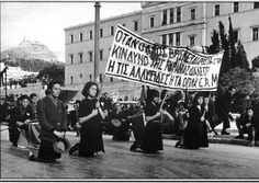 """Athens, Greece, December 5, 1944. This is the day after the slaughter of December 4 demonstration called by EAM (National Liberation Front). The banner reads: """"When the people faces the danger of tyranny, the people choose either the chains or the arms""""."""