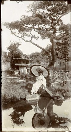 """Description: """"'In a Japanese Garden' study of a girl in a Japanese garden with her reflection in lake"""". Photograph taken by Herbert Ponting (1870-1935).  Date: c.1907   Our Catalogue Reference: COPY 1/507/200  This image is from the collections of The National Archives. Feel free to share it within the spirit of the Commons.  For high quality reproductions of any item from our collection please contact our image library."""