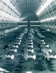 Biplanes inside Hangar One.