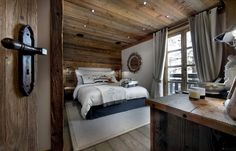 Chalet Interior with Warm Wood Decoration Ideas and Modern Home Appliances : Sleek Bedroom With White Rug At The Le Petit Chateau In The Chalet Interior Design