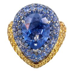 DE GRISOGONO Blue and Yellow Sapphire Gold Dome Ring Sz. 7 | From a unique collection of vintage dome rings at https://www.1stdibs.com/jewelry/rings/dome-rings/