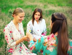 Set of 5 Custom floral bridal party robes by Singing Slowly. Beautiful bridesmaid robes and floral bridal robe for a garden wedding. Botanical wedding ideas. Ivory robes. Destination weddings ideas.