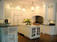 Bookcase with glass doors in the kitchen perfect for all your cookbooks!