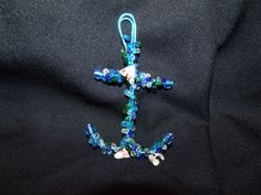Hand beaded wire wrapped anchor wall decor  http://www.artfire.com/ext/shop/product_view/Lil_Panther_Creations/4786787/Hand_beaded_wire_wrapped_anchor_wall_decor/Metal_Craft/Indoor_Decorations/Wall_Art#