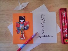 Congratulate with style: Handwritten Japanese congratulations card with detachable gift of Japanese paper doll by HarunaMarie, $6.95 USD