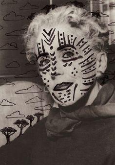 Karen Blixen.  Love this painted on tribal mask.  Nowadays women take on permanent tribal markings through Tattoos.