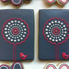 cute navy, red and white sugar biscuits with bird and tree detail