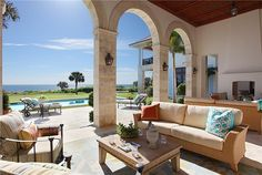 Mediterranean oceanfront patio and courtyard lap pool with authentic touches of the Cote d'Azur.