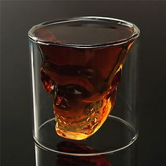 Ho ho ho, and a bottle of rum!  Scary or creative? Scull shaped whiskey glass at $3.59.