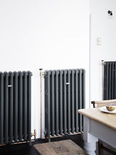 """The new, old-fashioned cast-iron radiators are the Radiator Company'sLedbury design with exposed copper piping: """"The refurbished radiators I've found are just a pain in the ass,"""" says Lewis."""